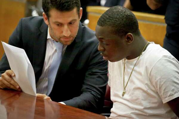 "Rapper Bobby Shmurda, whose birth name is Ackquille Pollard, right, confers with his lawyer Alex Spiro in a Manhattan court on Wednesday Oct. 19, 2016, in New York. Shmurda, best known for ""Hot Boy,"" a gritty hit song with rhymes about street violence, was sentenced to seven years in prison on charges he conspired with a drug gang in several shootings. (AP Photo/Bebeto Matthews) ORG XMIT: NYBM102"