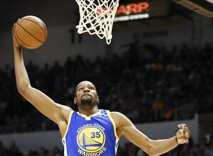 Golden State Warriors forward Kevin Durant (35) goes up for a dunk during the first half of an NBA preseason basketball game against the Los Angeles Lakers on Wednesday, Oct. 19, 2016, in San Diego. (AP Photo/Denis Poroy