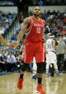 Houston Rockets guard Eric Gordon (10) heads to the bench during the second half of an NBA preseason basketball game against the Dallas Mavericks Wednesday, Oct. 19, 2016, in Dallas. (AP Photo/LM Otero)