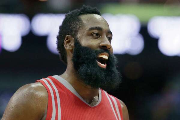 Houston Rockets guard James Harden heads to the bench during the second half of the team's NBA preseason basketball game against the Dallas Mavericks Wednesday, Oct. 19, 2016, in Dallas. (AP Photo/LM Otero)