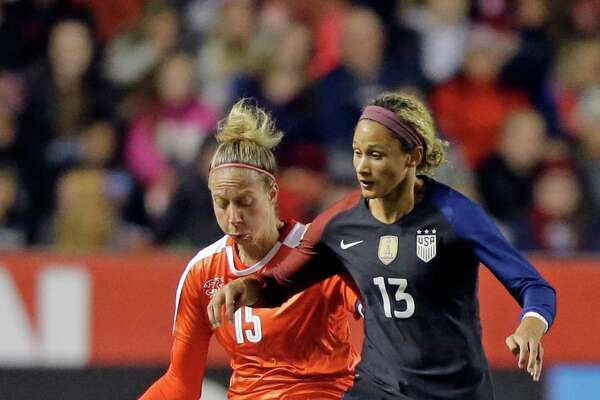 Switzerland's Caroline Abbe (15) defends United States' Lynn Williams (13) during the second half of an international friendly soccer match Wednesday, Oct. 19, 2016, in Sandy, Utah. The United States won 4-0. (AP Photo/Rick Bowmer)