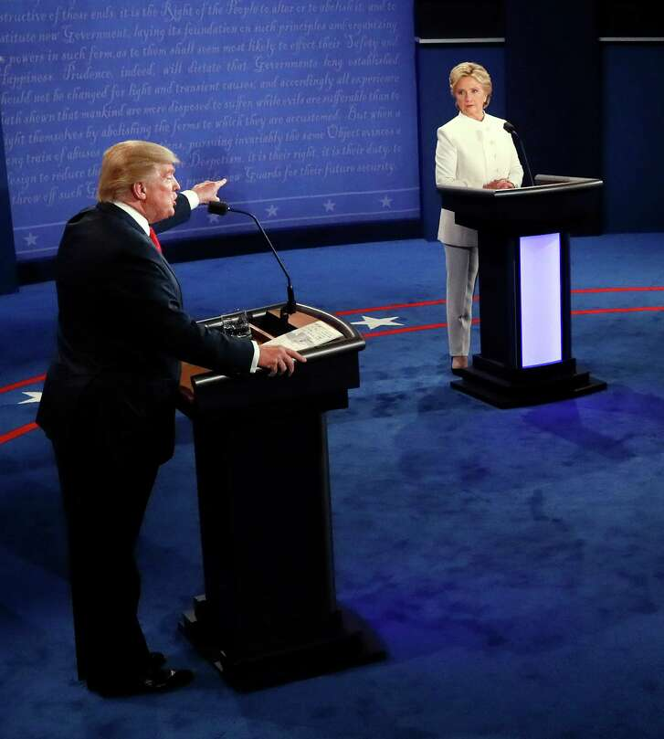 Republican presidential nominee Donald Trump debates Democratic presidential nominee Hillary Clinton during the third presidential debate at UNLV in Las Vegas on Wednesday. (Mark Ralston/Pool via AP)