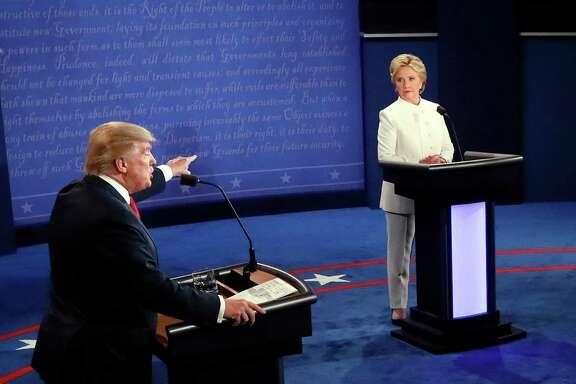 Republican presidential nominee Donald Trump debates Democratic presidential nominee Hillary Clinton during the third presidential debate at UNLV in Las Vegas on Wednesday. (Mark Ralston/Pool via AP)