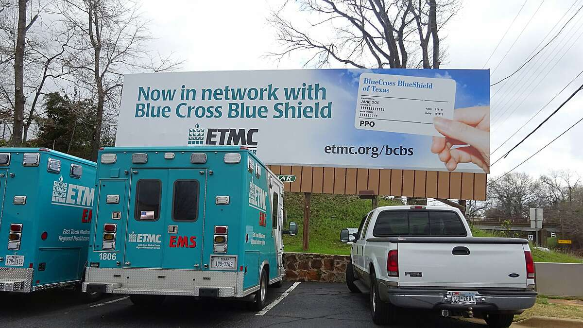 FILE - An undated photograph of a Blue Cross Blue Shield billboard in Tyler, Texas. Monday, the insurance company began a new policy of not paying the expenses for out-of-network emergency room visits if it is determined that patients could have gone elsewhere for treatment.