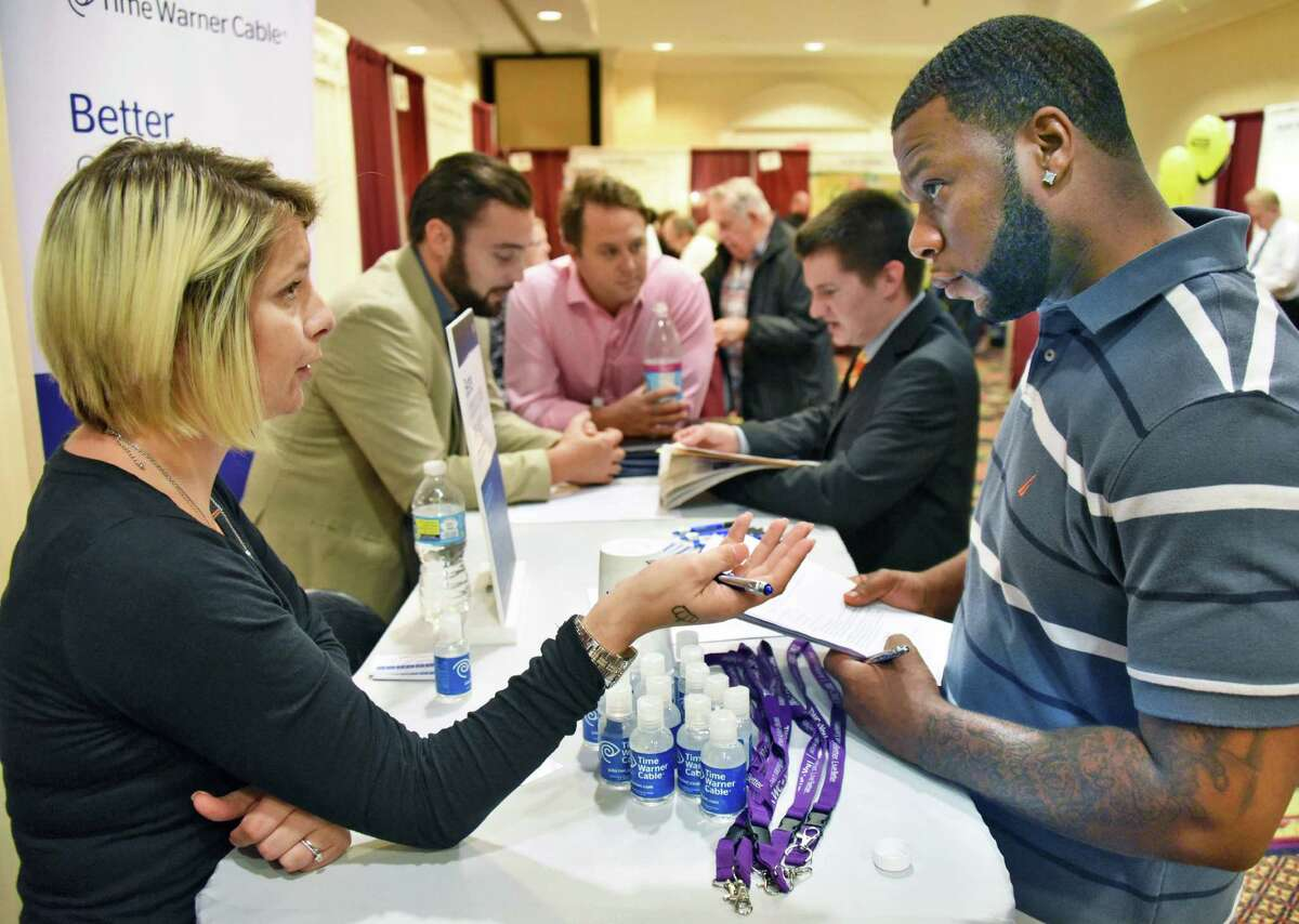 TWC's Darci Ellis, left, speaks Raheem Brown of Troy during the Times Union Job Fair at the Albany Marriott Wednesday Oct. 19, 2016 in Colonie, NY. (John Carl D'Annibale / Times Union)