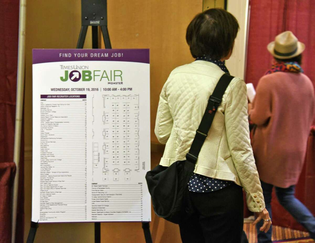 Job seekers enter last October's Times Union Job Fair at the Albany Marriott in Colonie, NY. (John Carl D'Annibale / Times Union)