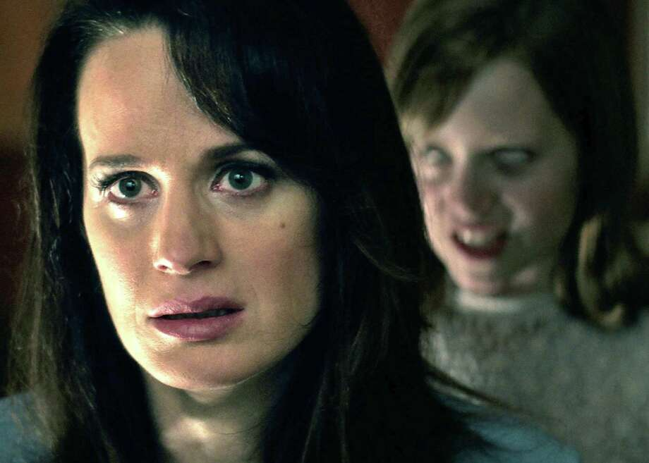 """Mom Alice (Elizabeth Reaser) probably wouldn't like the answer weirdo daughter Doris (Lulu Wilson) would provide in """"Ouija: Origin of Evil."""" The well-written and -acted sequel to the high-grossing and widely despised 2014 """"Ouija"""" is fun, if not terrifying. Photo: RJ / Universal Pictures / Copyright: © 2016 Universal Studios. ALL RIGHTS RESERVED."""