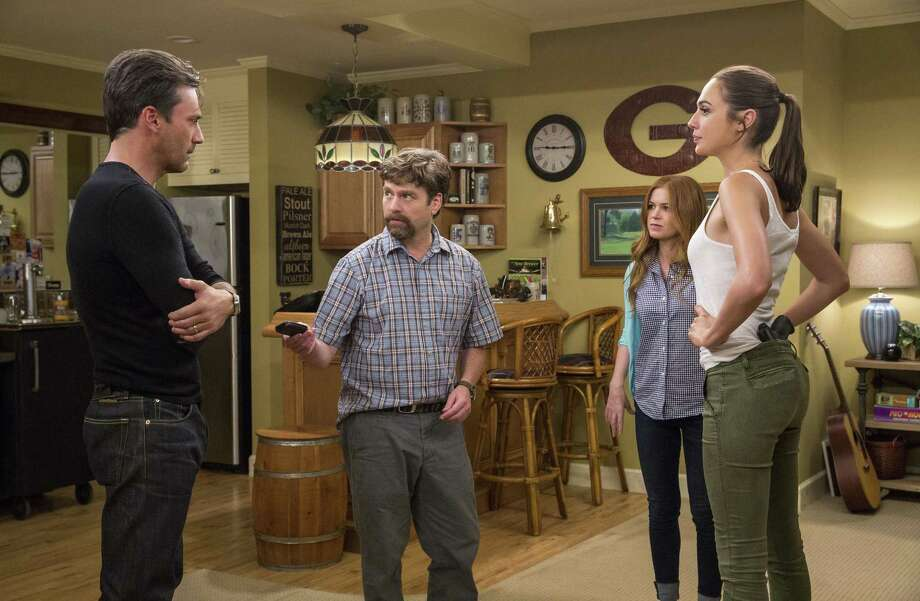 "This image released by Twentieth Century Fox shows, from left,  Jon Hamm, Zach Galifianakis, Isla Fisher and Gal Gadot in ""Keeping Up With The Joneses."" (Bob Mahoney/Twentieth Century Fox via AP) Photo: Bob Mahoney, HONS / Associated Press / TM & © 2016 Twentieth Century Fox Film Corporation. All Rights Reserved. Not for sale or duplication."