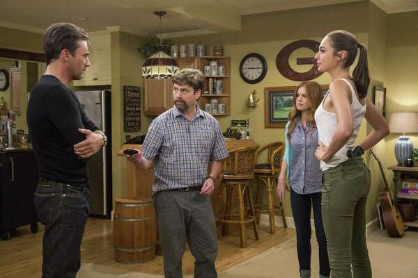 "This image released by Twentieth Century Fox shows, from left,  Jon Hamm, Zach Galifianakis, Isla Fisher and Gal Gadot in ""Keeping Up With The Joneses."" (Bob Mahoney/Twentieth Century Fox via AP)"