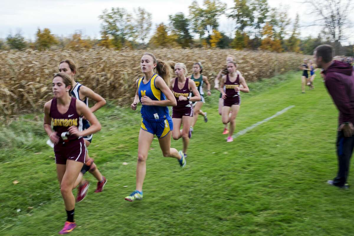 Midland High School runner Riley Legge competes in the Saginaw Valley League cross country championship at Delta College on Wednesday.