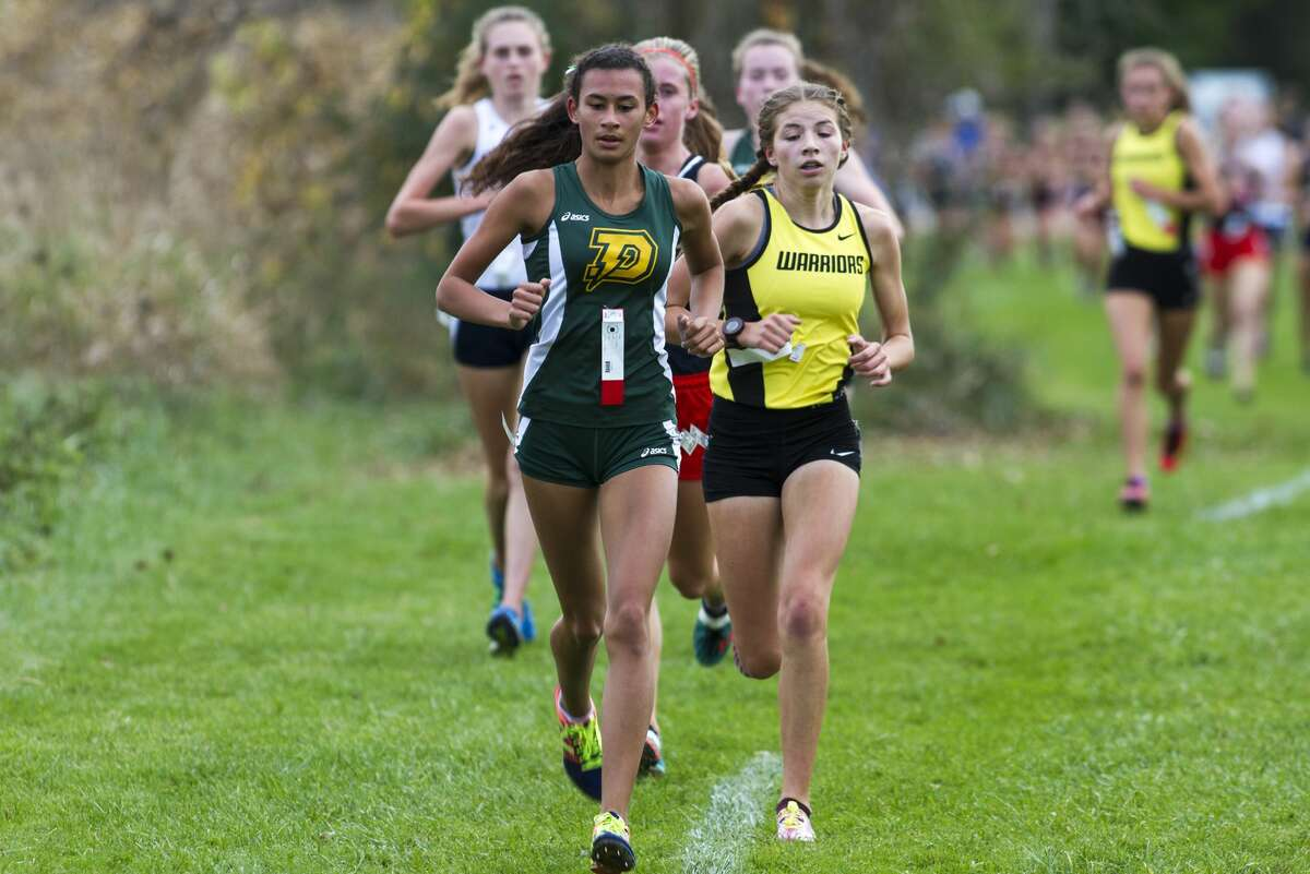 Dow High School runner Maija Rettelle competes in the Saginaw Valley League cross country championship at Delta College on Wednesday.