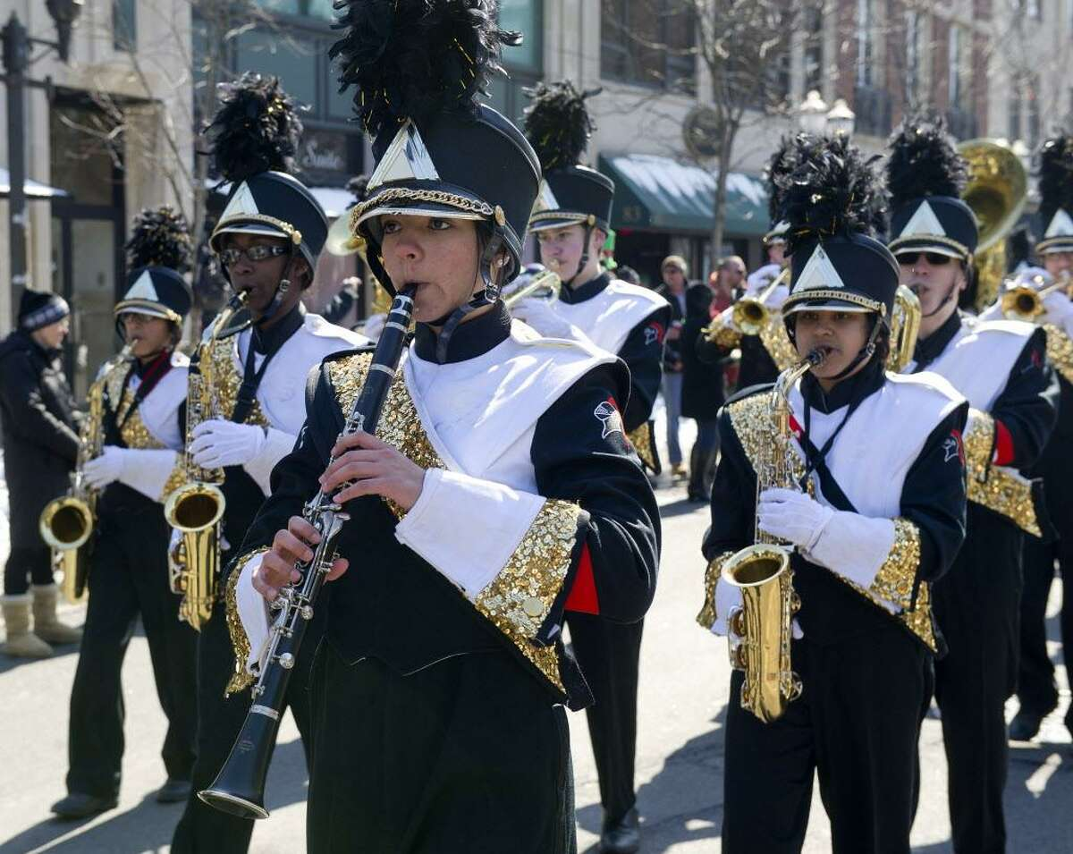 FILE - The Stamford High School marching band performs during the St. Patrick's Day Parade in Stamford, Conn., on Saturday, March 7, 2015.