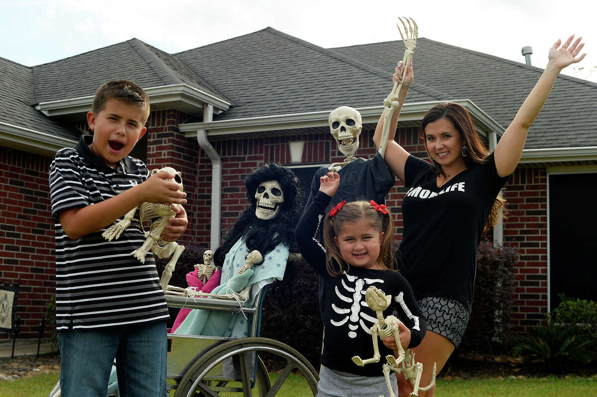 Amy B. Moses and her children, Macy, 4, and Canon, 10, set up a new scene with the skeleton family in their Lumberton yard every day. Fans can follow the Bones family on her Facebook page