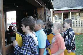 Two second grade classes from Bad Axe Elementary ventured to the Bad Axe Log Cabins this week.