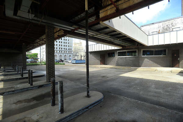 """Tom Broussard envisions great things for the former Capital One motor bank building on Fannin Street in the heart of downtown Beaumont. The site is undergoing cleaning and construction as part of the """"Repurposed Living Project,"""" and will eventually become his home. It sits adjacent to the building in which his great-grandfather had a livery business, making it especially valuable when it became available to purchase last year. Broussard says repurposing the building into a single family dwelling was welcomed by the city and downtown development as part of the move toward revitalization of the downtown area. Photo taken Wednesday, October 19, 2016 Kim Brent/The Enterprise"""