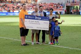 JC Sports Houston is awarded $10,000 as the winner of The Pitch Small Business Contest Oct. 16 at BBVA Compass Stadium. From left to right: Larry Franco, BBVA representative; Cesar Coronel, owner of JC Sports Houston; Chris Canetti, Houston Dynamo president of business operations; Jennifer Coronel, owner of JC Sports Houston; and sons Caleb Coronel and Kalel Coronel.