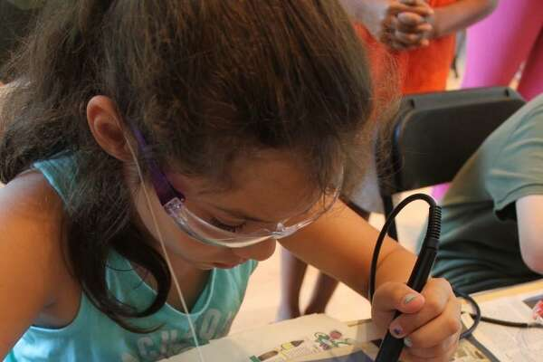 Resident Ally Colavecchio learns how to solder during last year's Innovation Day event.