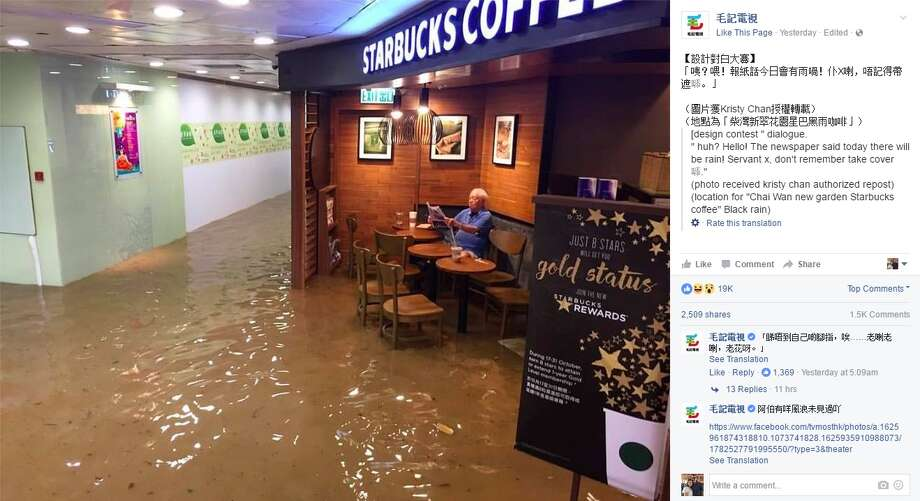 An image of a man in Hong Kong sitting undisturbed by flooding at a Starbucks was posted to TV Most's Facebook page Oct. 19, 2016. Since then, the photo has gone viral. Photo: Courtesy/Facebook