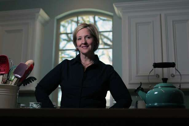 Brené Brown, research professor at the University of Houston Graduate College of Social Work who writes and lectures on vulnerability, shame and courage, poses for a portrait in her home Wednesday, Jan. 30, 2013, in Houston. ( James Nielsen / Chronicle )