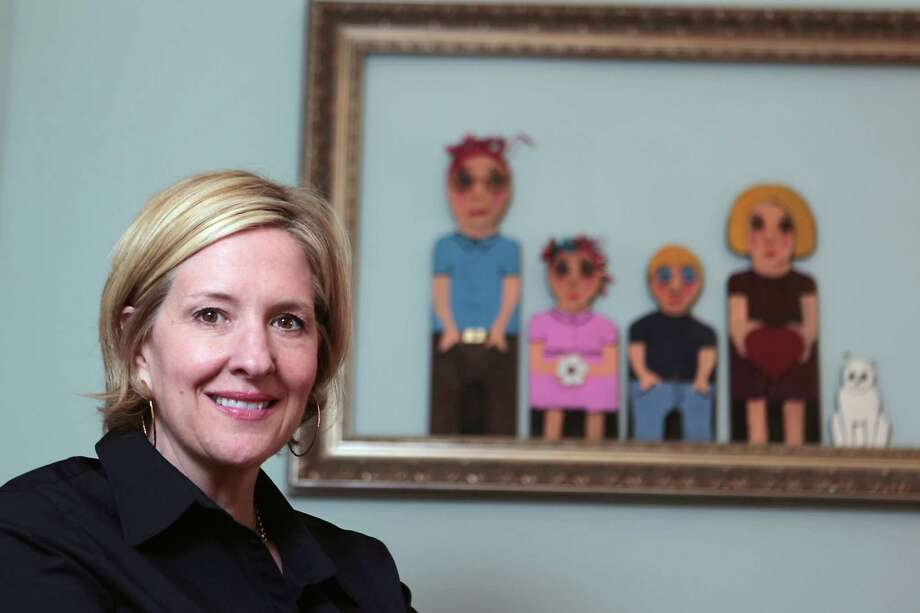 Brené Brown, research professor at the University of Houston Graduate College of Social Work who writes and lectures on vulnerability, shame and courage, poses for a portrait in her home Wednesday, Jan. 30, 2013, in Houston.