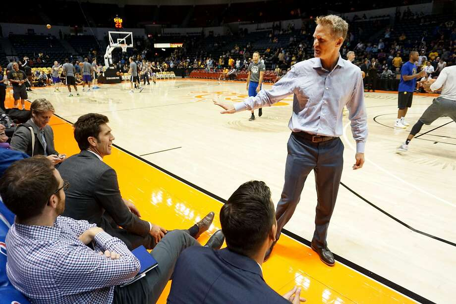 Warriors' GM Bob Myers chats with coach Steve Kerr  before game against the LA Lakers at the Valley View Casino Center in San Diego, CA on Wednesday, October 19, 2016.  In addition to building what is expected to be a historically good Warriors team, Myers has been helping his sister-in-law through tragedy. His brother-in-law was killed in a hiking accident in Africa - which his sister-in-law witnessed. Photo: Sandy Huffaker, Special To The Chronicle