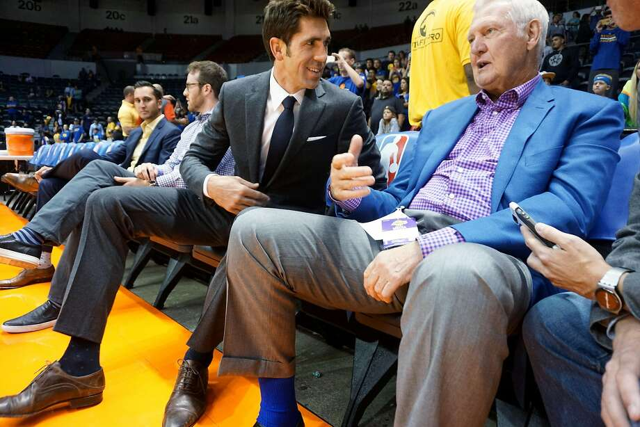 Warriors' GM Bob Myers chats with Jerry West before  game against the LA Lakers at the Valley View Casino Center in San Diego, CA on Wednesday, October 19, 2016.  In addition to building what is expected to be a historically good Warriors team, Myers has been helping his sister-in-law through tragedy. His brother-in-law was killed in a hiking accident in Africa - which his sister-in-law witnessed. Photo: Sandy Huffaker, Special To The Chronicle