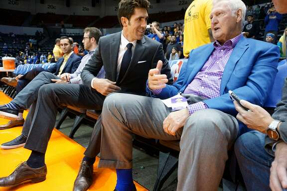 Warriors' GM Bob Myers chats with Jerry West before  game against the LA Lakers at the Valley View Casino Center in San Diego, CA on Wednesday, October 19, 2016.  In addition to building what is expected to be a historically good Warriors team, Myers has been helping his sister-in-law through tragedy. His brother-in-law was killed in a hiking accident in Africa - which his sister-in-law witnessed.