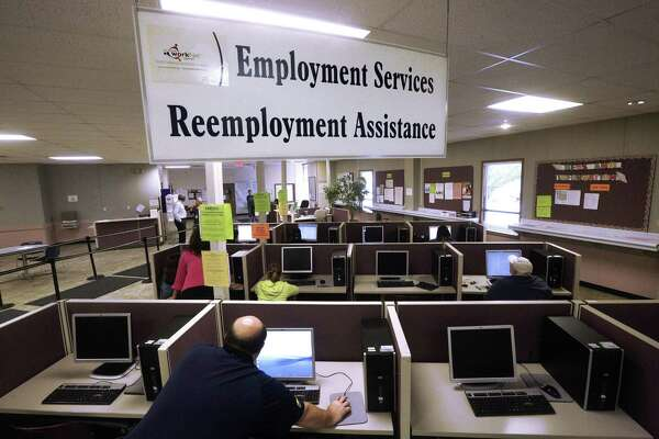 FILE - This Thursday, Sept. 29, 2016, file photo, shows the Illinois Department of Employment Security office in Springfield, Ill. On Thursday, Oct. 20, 2016, the Labor Department reports on the number of people who applied for unemployment benefits the week before. (AP Photo/Seth Perlman, File)