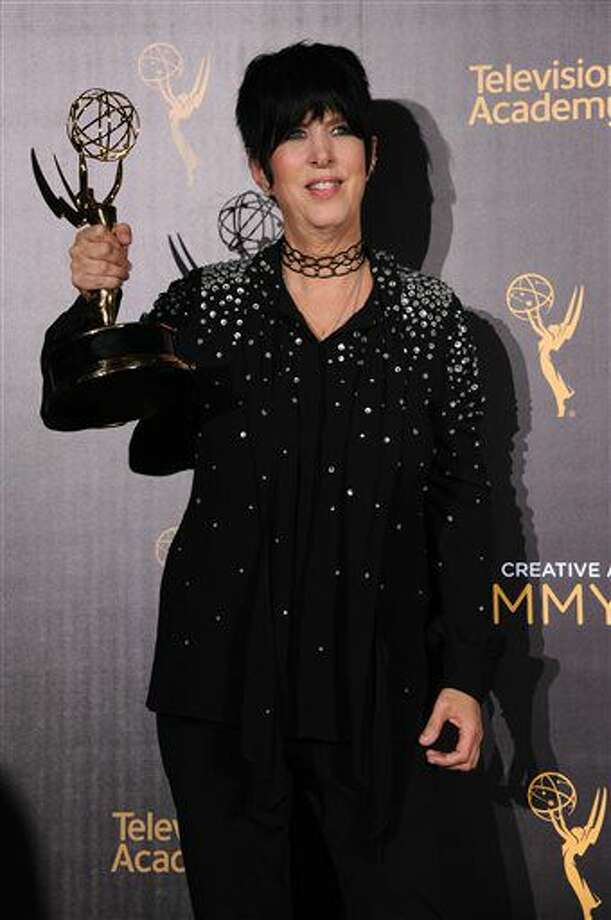 """Diane Warren poses in the press room with the award for outstanding original music and lyrics for """"'Til it Happens to You"""" from """"The Hunting Ground"""" during night one of the Creative Arts Emmy Awards at the Microsoft Theater on Saturday, Sept. 10, 2016, in Los Angeles. (Photo by Richard Shotwell/Invision/AP)"""