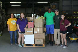 School supplies from the Texas Panhandle were unloaded by, from left to right, Misti Ivins, Texas A&M AgriLife Extension Service representative from Moore County, and Louisiana State University students Cole Daniels, Xavier Bell, Austin Terrell and Jamie Granier.