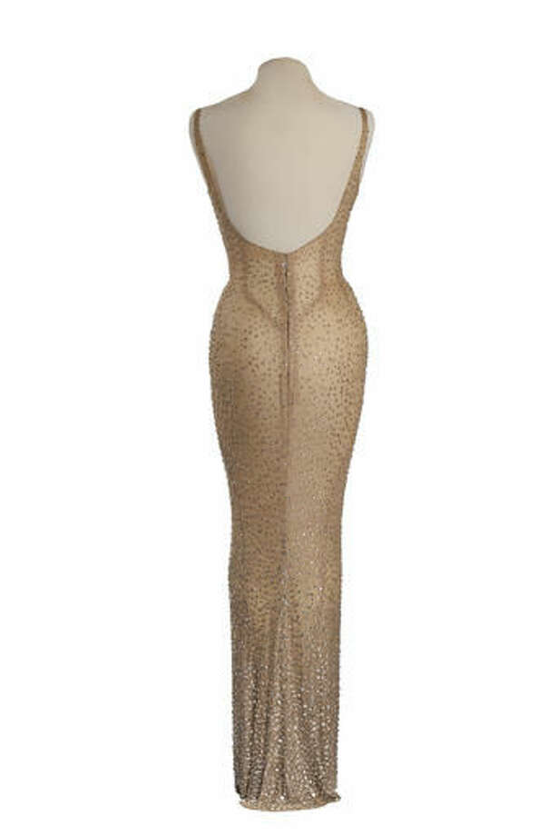 """This undated photo provided by Julien's Auctions shows the back view of the flesh-colored dress Marilyn Monroe wore during her rendition of """"Happy Birthday"""" to President John F. Kennedy. Julien's Auctions is offering the sequined stunner in Los Angeles on Nov. 17, 2016. (Julien's Auctions via AP)"""