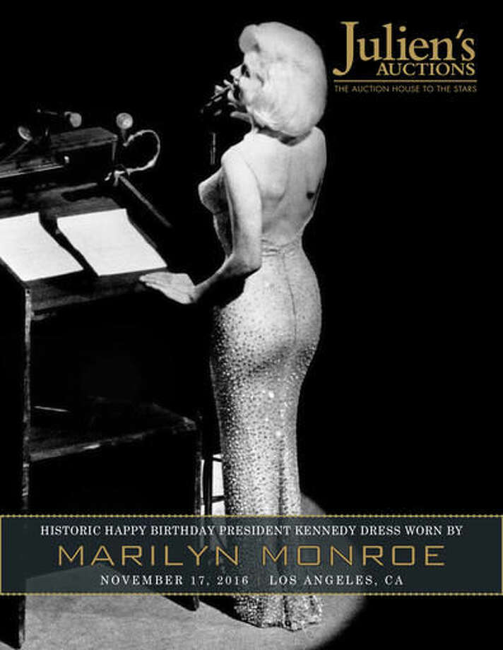"""This undated photo provided by Julien's Auctions shows Marilyn Monroe singing her breathless """"Happy Birthday"""" to President John F. Kennedy. The barely-there flesh-colored dress she wore is going on the auction block in the fall. Julien's Auctions is offering the sequined stunner in Los Angeles on Nov. 17, 2016. It conservatively estimates it could fetch between $2 million to $3 million. The dress was last auctioned in 1999 for $1.26 million. (Julien's Auctions via AP)"""