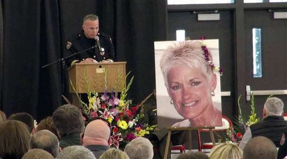 In this April 5, 2014 photo provided by Medford Police Department, Medford Police Department Deputy Chief Brett Johnson speaks at a celebration of life ceremony at Ashland High School for Karen Greenstein, in Ashland Ore. The trial of a Grants Pass man charged with killing an emergency dispatcher in a wrong-way collision on Interstate 5 while he was intoxicated is set to begin two years after the woman's death. The Mail Tribune reports Richard Webster Scott is scheduled for trial Tuesday, Sept. 20, 2016, on charges of manslaughter and driving under the influence in connection with the March 2014 crash that killed 58-year-old Karen Greenstein. (Medford Police Department/Medford Mail Tribune via AP)