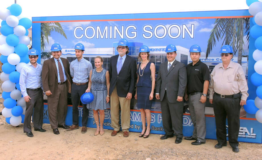 Elizabeth, Hank and Evelyn Sames, center, were joined by management team members after they broke ground Wednesday for the Sames Honda dealership off Loop 20.