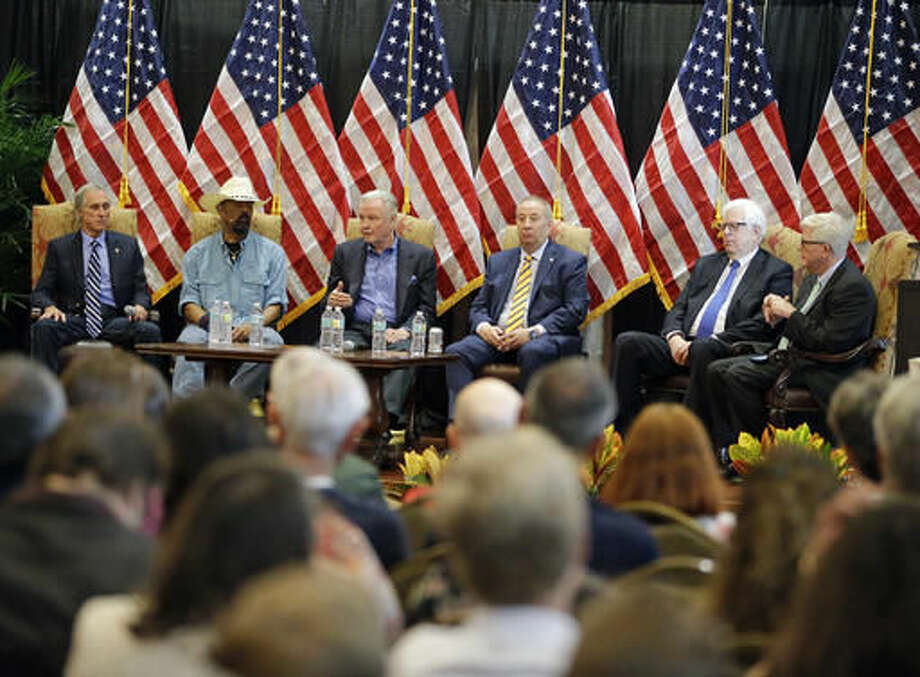 In this Monday, Sept. 12, 2016 photo, Donald Trump supporters from left, Chris Hart, radio personality, David A. Clarke Jr.,Sheriff of Milwaukee County, Wis., actor Jon Voight, radio personality's Mike Gallager, Dennis Prager, and Hugh Hewitt, take part in a town hall meeting with the Great American PAC in Lake Mary, Fla. The Great America PAC is rolling through battleground states, opening offices and registering voters. Presidential hopefuls often embark on bus tours to meet voters across the country. This time, a super PAC is standing in for Republican nominee Donald Trump. (AP Photo/John Raoux)