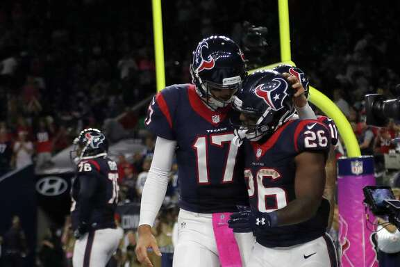 Houston Texans quarterback Brock Osweiler (17) celebrates with running back Lamar Miller (26) after his touchdown during the fourth quarter of an NFL football game at NRG Stadium, Sunday,Oct. 16, 2016 in Houston.   ( Karen Warren / Houston Chronicle )