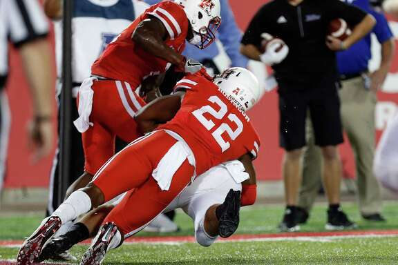 Austin Robinson's dramatic goal-line tackle preserved UH's win over Tulsa.