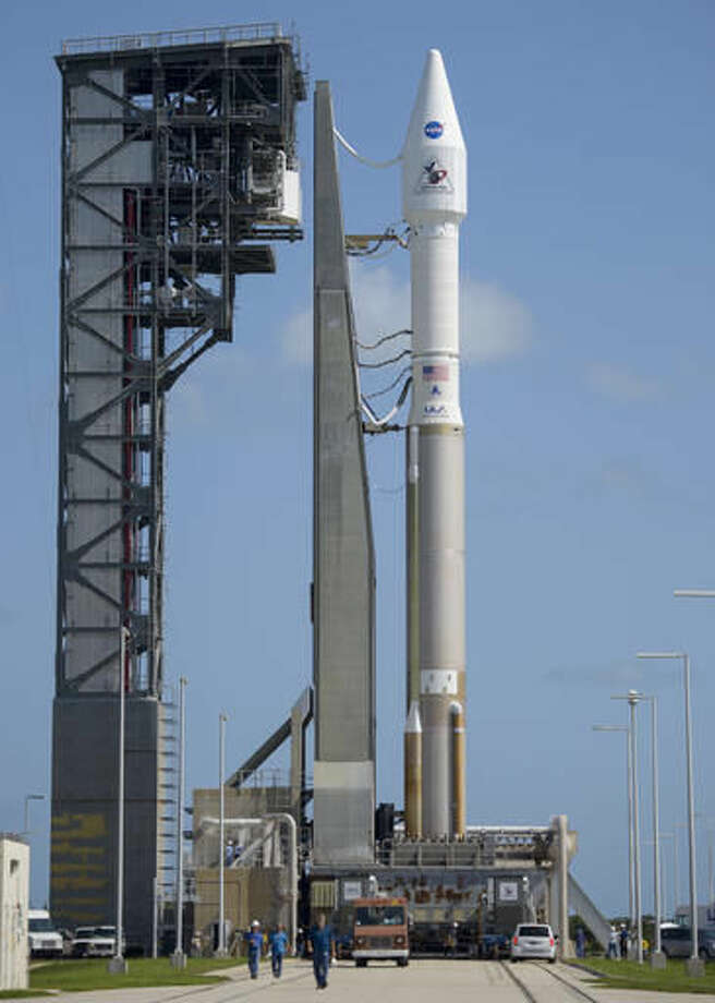 A United Launch Alliance Atlas V rocket, carrying NASA's OSIRIS-REx spacecraft, sits at its launchpad at Cape Canaveral Air Force Station in Florida on Wednesday, Sept. 7, 2016. The mission, scheduled to launch on Sept. 8, is the first U.S. attempt to reach an asteroid return a sample to Earth for study. (NASA/Joel Kowsky via AP)