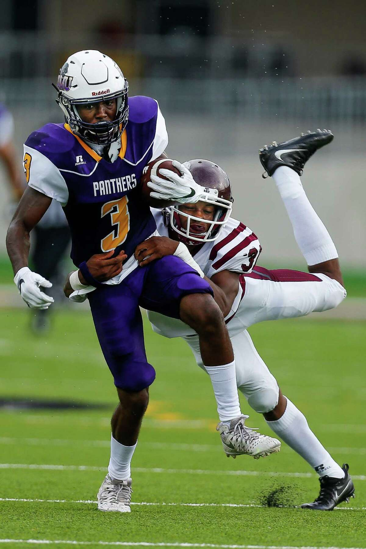 Texas Southern Tigers defensive back Andre Joseph (31) tackles Prairie View Am Panthers wide receiver Joshua Simmons (3) after a catch as the Prairie View Am Panthers take on the Texas Southern Tigers at Panther Stadium at Blackshear Field Sunday, September 4, 2016 in Prairie View. ( Michael Ciaglo / Houston Chronicle )