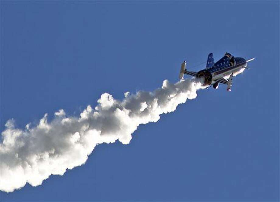 "Stuntman Eddie Braun flies the ""Evel Spirit"" rocket on Friday, Sept. 16, 2016, over the Snake River Canyon at Twin Falls, Idaho. (Pat Sutphin/The Times-News via AP)"