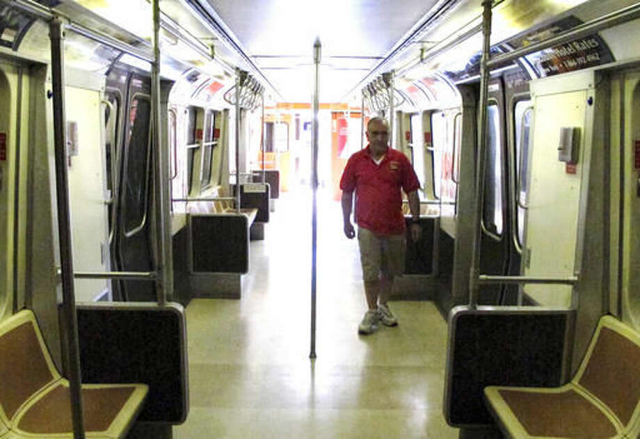 In this Aug. 17, 2016 photo, John Proto, director of the Shore Line Trolley Museum walks inside PATH car 745 at the museum in East Haven, Conn. The subway car was beneath the World Trade Center in New York during the terrorist attack on Sept. 11, 2001. The museum will dedicate and open to the public an exhibit featuring the car on Sept. 11, 2016. (AP Photo/Dave Collins)