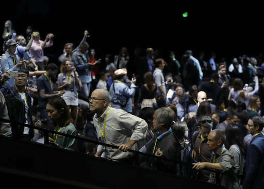 People enter the auditorium before an event to announce new Apple products, Wednesday, Sept. 7, 2016, in San Francisco. (AP Photo/Marcio Jose Sanchez)