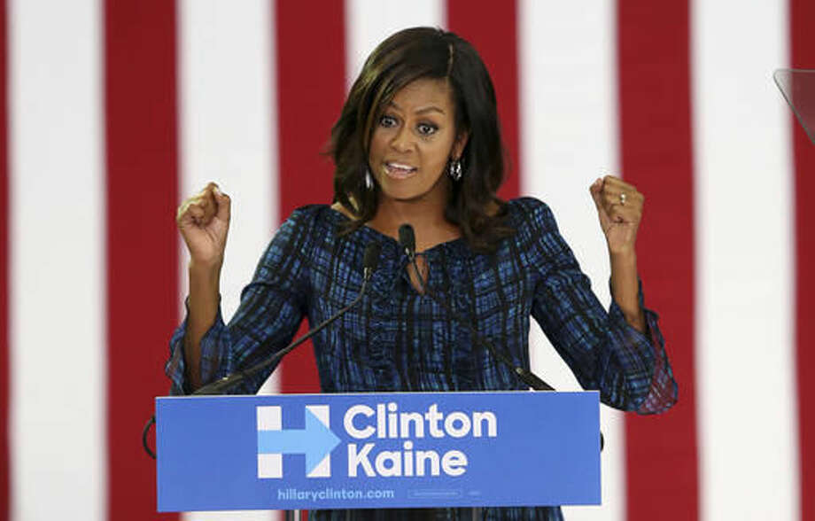 First lady Michelle Obama speaks at LaSalle University in Philadelphia, Wednesday, Sept. 28, 2016, as she campaigns for presidential candidate Hillary Clinton. (AP Photo/Mel Evans)