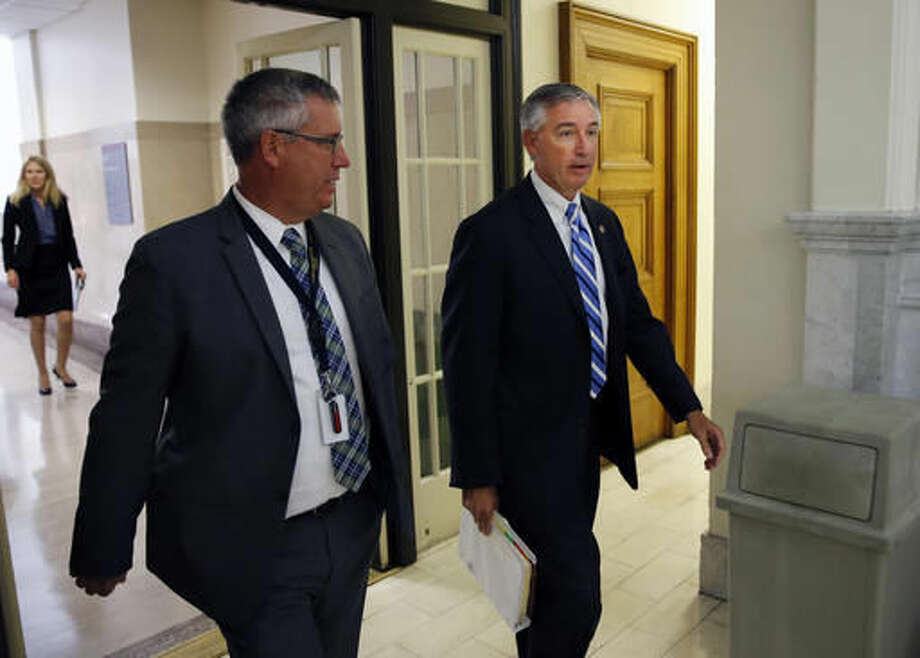 Montgomery County District Attorney Kevin Steele, right, walks to Courtroom A in the Montgomery County Courthouse Tuesday, Sept. 6, 2016, in Norristown, Pa., for the pre-trial conference with Bill Cosby and his attorneys. Bill Cosby returns to the Montgomery County Courthouse Tuesday for a pre-trial conference in his sexual assault case and to set a trial date. The defense also will push on Tuesday to keep key evidence out of the case. (Michael Bryant/The Philadelphia Inquirer via AP, Pool)