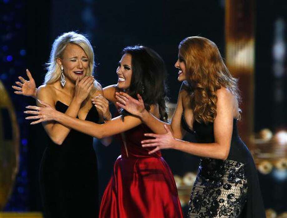 Miss Arkansa Savvy Shields, is congratulated by Miss Maryland Hannah Brewer, center, and Miss Texas Caroline Carothers, after being named Miss America 2017, Sunday, Sept. 11, 2016, in Atlantic City, N.J. (AP Photo/Noah K. Murray)