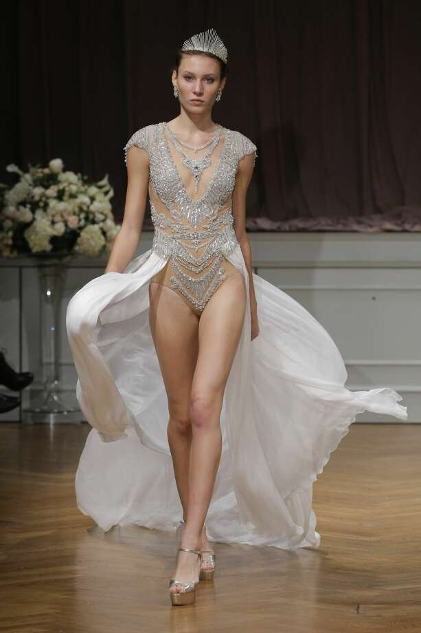 Channel your inner Beyonce in this Alon Livne bridal bodysuit. Grandma and guests probably won't know where to look first, your legs or the sheerness of the actual bodysuit. Photo: JP Yim/Getty Images For ALON LIVNE