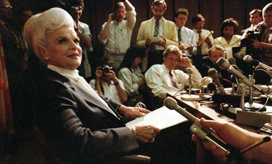 In this April 5, 1988 photo, then Arizona Gov. Rose Mofford chats with reporters in her office in Phoenix after being sworn-in following the impeachment of Gov. Evan Mecham. Mofford, Arizona's first female governor and a shepherd for the state during a period of political turbulence, died Thursday, Sept. 15, 2016, a former spokeswoman said. She was 94. (David Sanders /Arizona Daily Star via AP)