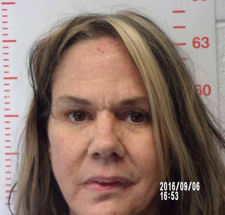 This Sept. 6, 2016 photo provided by the Polk County Sheriff's Office in Bolivar, Mo., shows Kimberly Lightwine, of Aldrich, Mo. Lightwine, who was found lying near the body of her blind and autistic son in a field near Morrisville, Mo., on Aug. 29, was charged Saturday, Sept. 3, with second-degree murder in his death. (Polk County Sheriff's Office via AP)