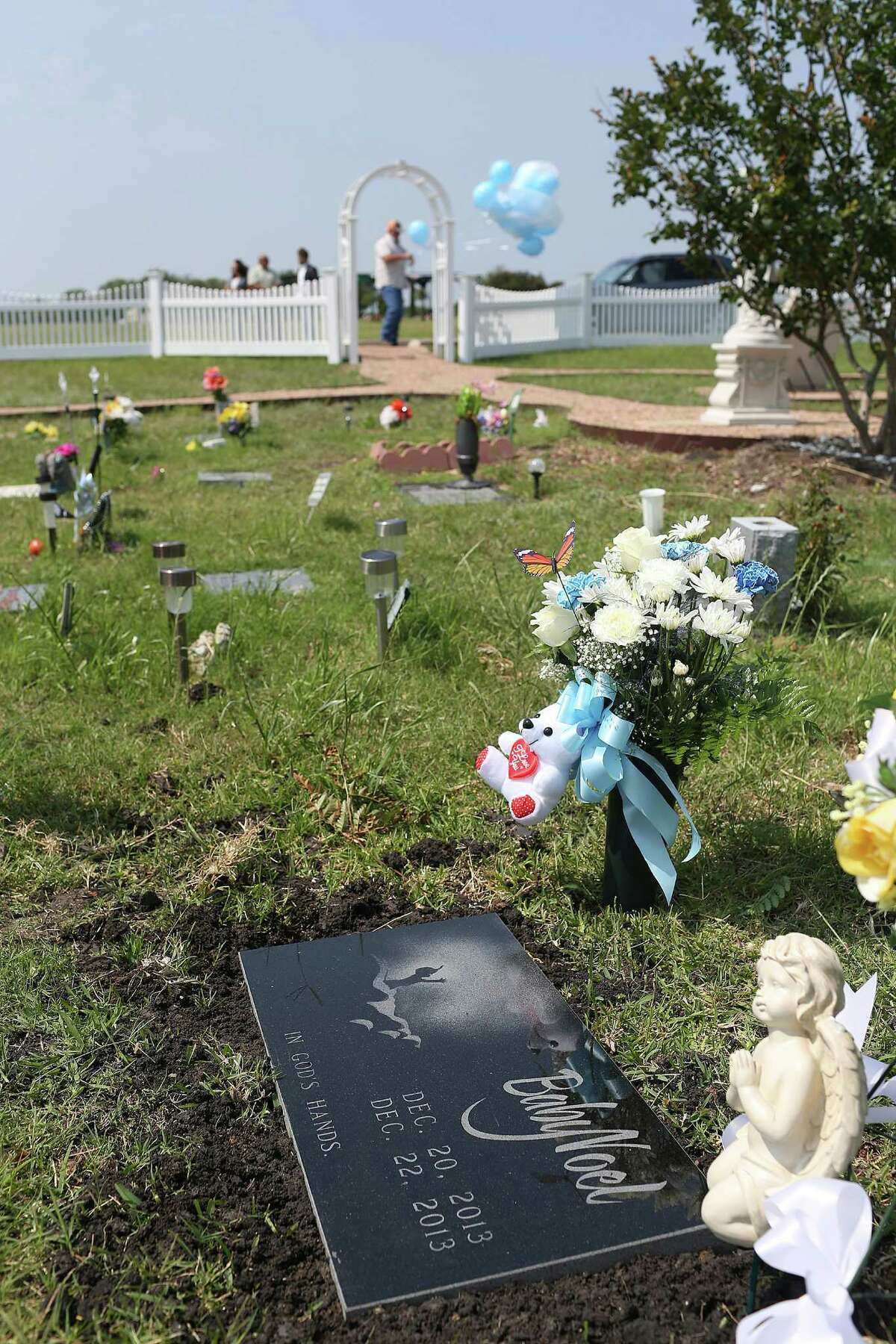 A headstone marks the spot of Baby Noel's burial site at the Chapel Hill Memorial Gardens, Wednesday, May 11, 2016. A service was held to place the headstone at the gravesite where he was buried on March 22, 2014. The body of the two-day-old baby was in a duffle bag when it was found by a Waste Management employee at the San Antonio Houston Street Recycle Center located in the 5600 block of FM 1346 in December of 2014. The mother of the baby boy, Nidia Yolibeth Alvarado, is suspected of strangling the baby because she didn't want another child and now faces capital murder charges. Tim and Pamela Allen adopted the Baby Noel in order to legally bury the baby. Pamela Allen noted that the service wasn't just about placing a headstone on the grave but also