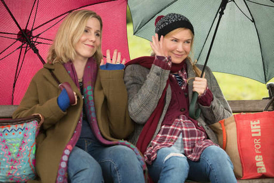 """This image released by Universal Pictures shows Sally Phillips, left, and Renee Zellweger in a scene from """"Bridget Jones's Baby."""" (Giles Keyte/Universal Pictures via AP)"""